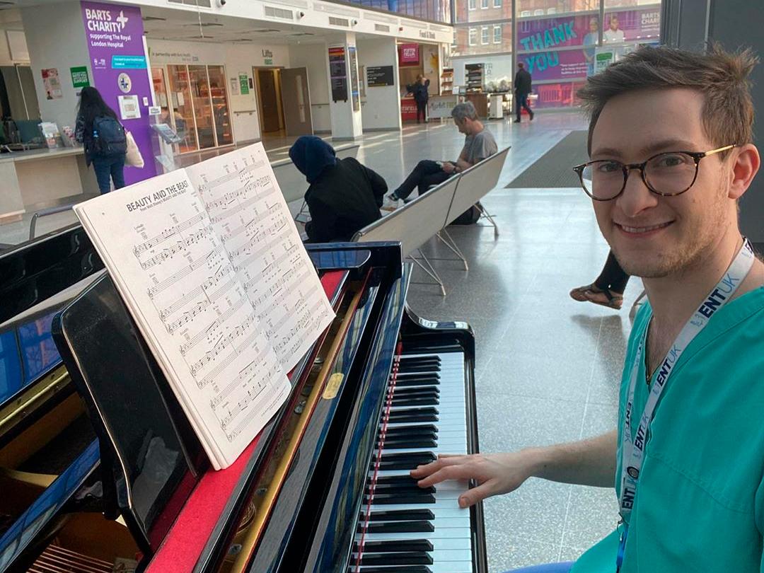 Fundraiser playing piano at The Royal London Hospital