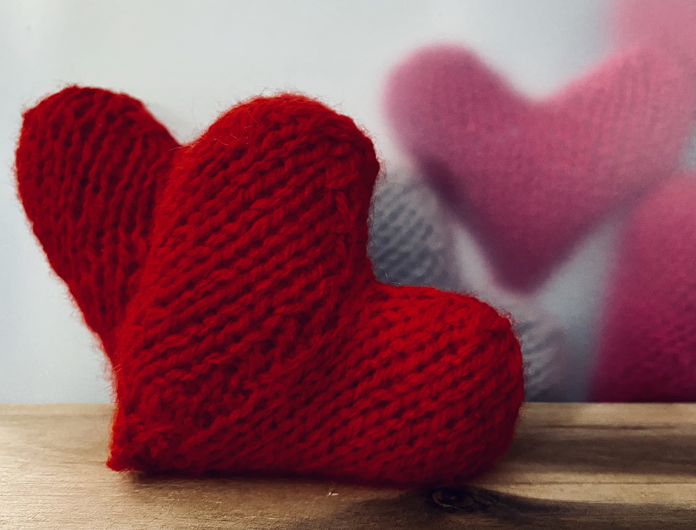 Hearts knitted as part of fundraising activity for COVID appeal