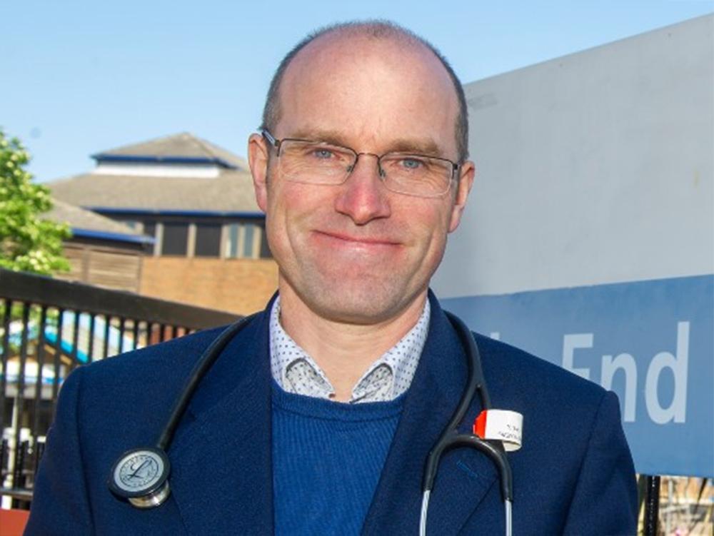 Professor Martinaeu in front of Mile End Hospital
