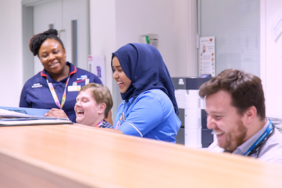 Nursing team laugh together on the ward