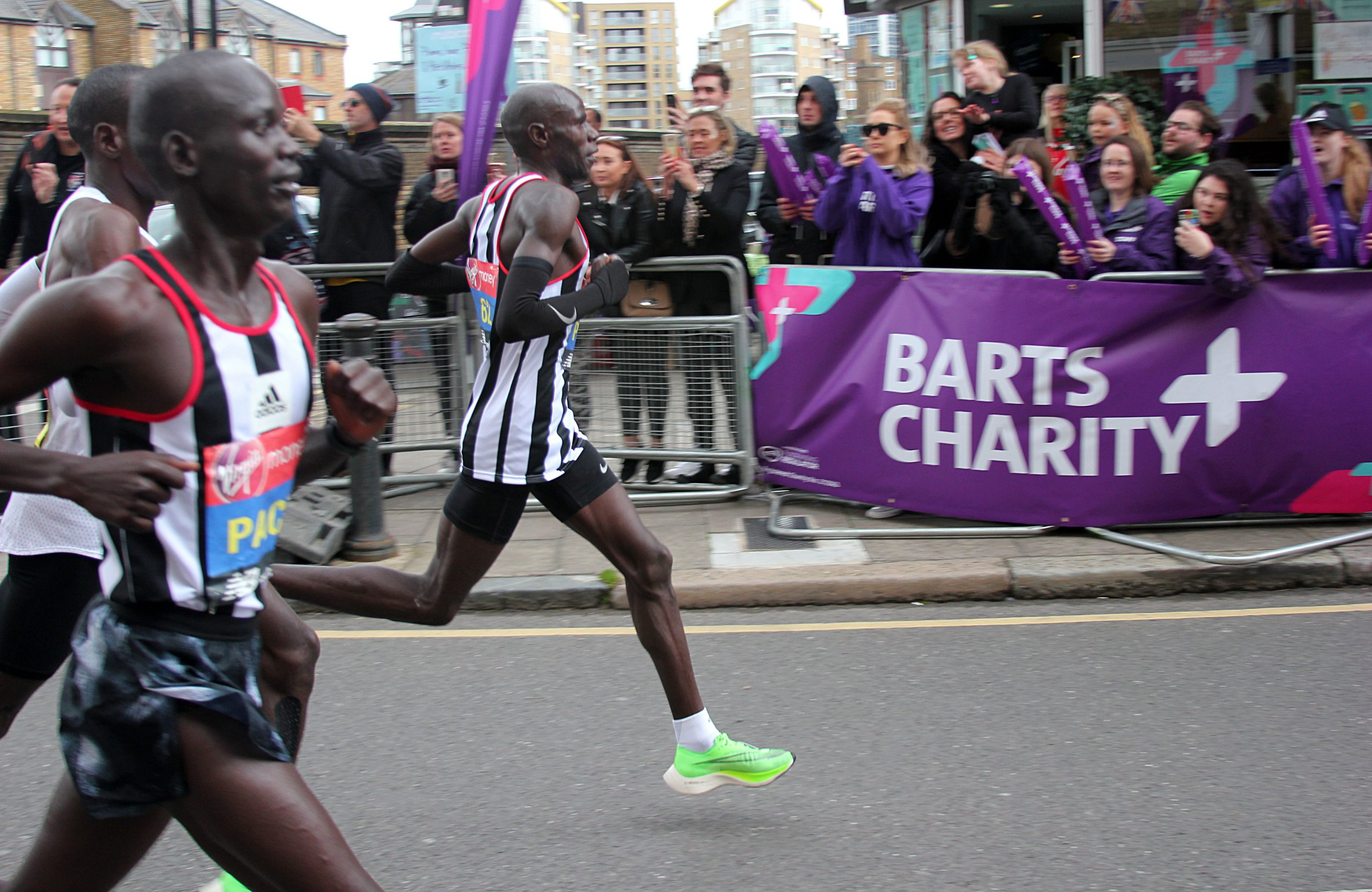 Runners for the London Marathon passing the Barts Charity cheer point