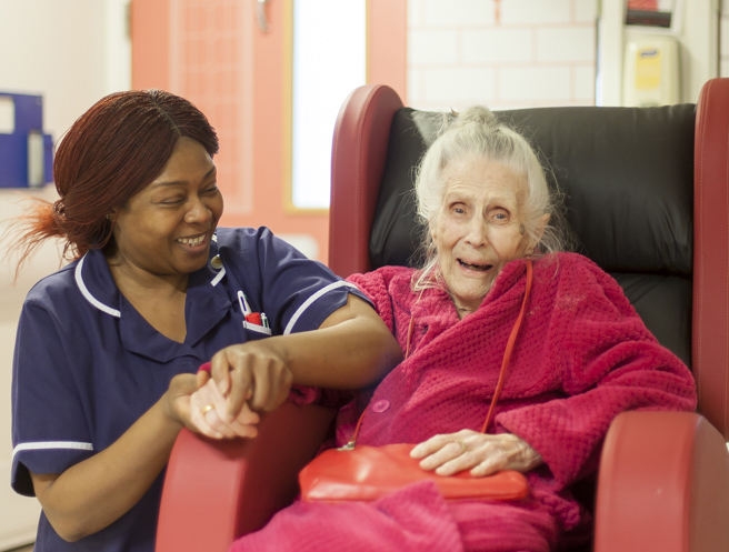 Older patient in chair with nurse