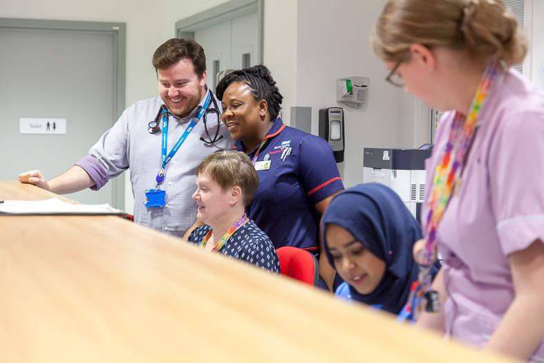 Nursing team talking on ward