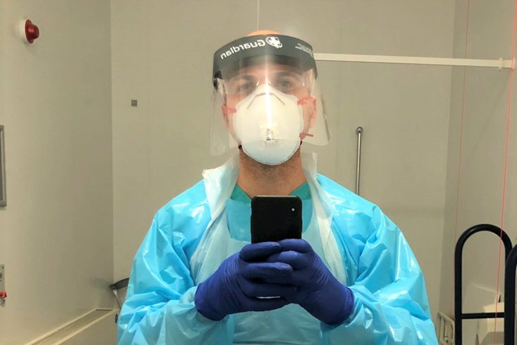 Hassan in PPE during the COVID-19 peak