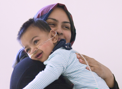 Woman holding her child