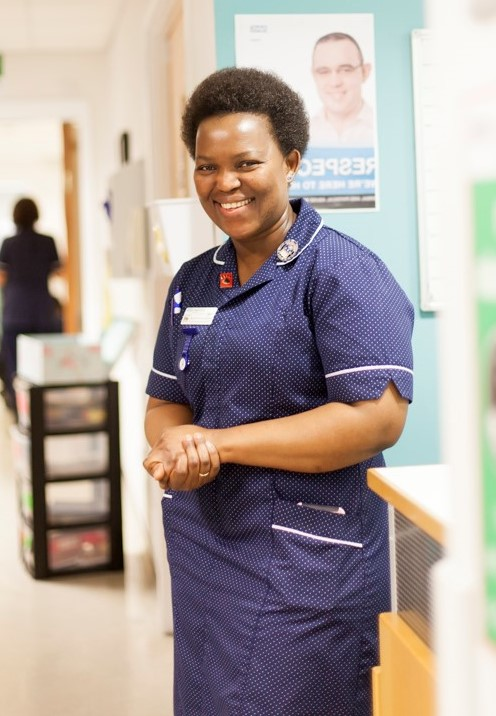 Nurse smiling on hospital ward