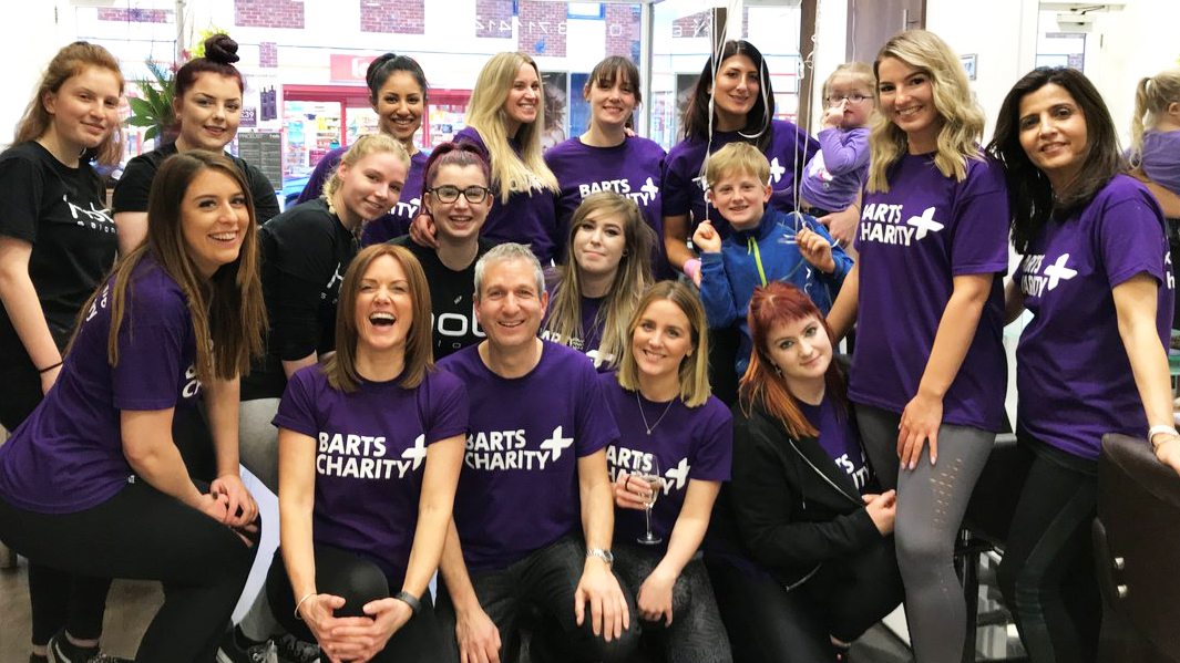 Large group of workers wearing Barts Charity t-shirts