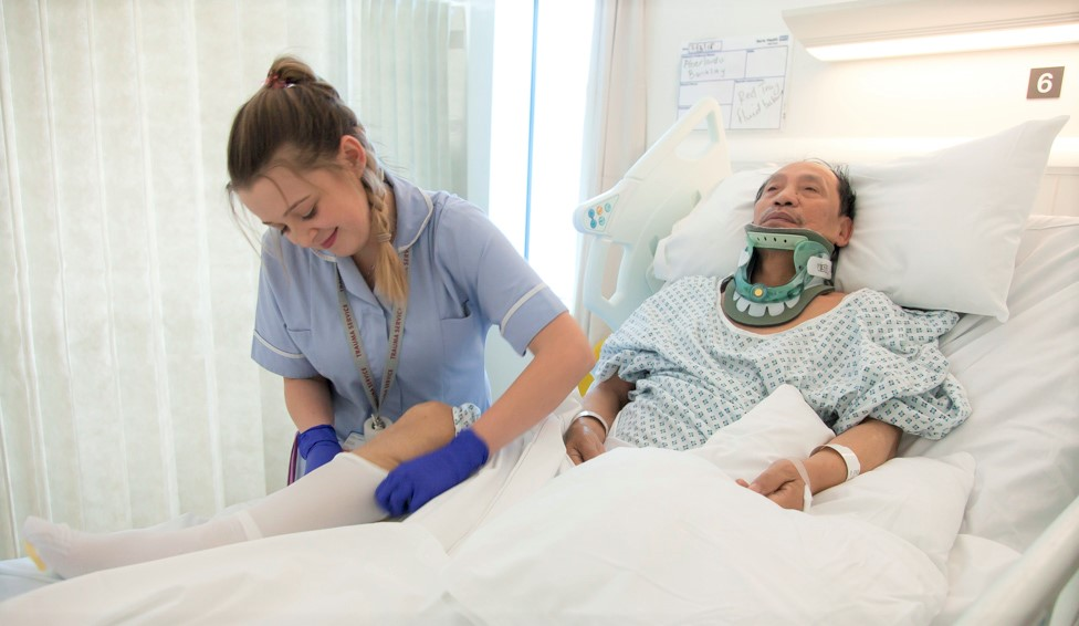 Nurse helping trauma patient at The Royal London Hospital