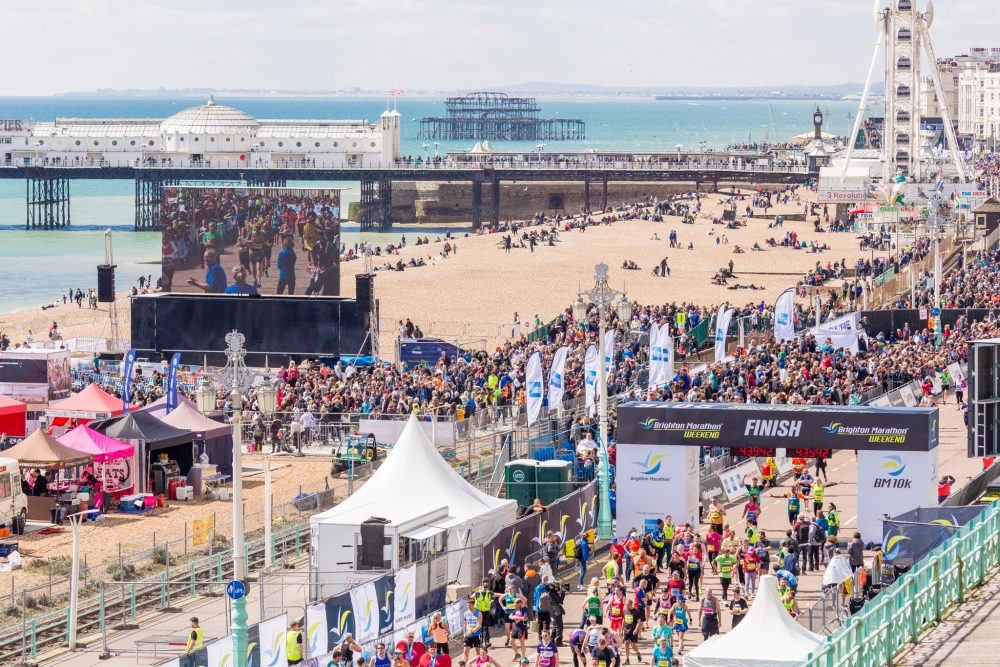 Start of the Brighton Marathon, with the beach in the background and runners in the foreground